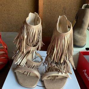 Brand new Steve Madden tassel heels. Never worn!